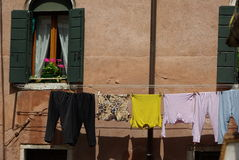 Hanging wet clothes in line Royalty Free Stock Photos