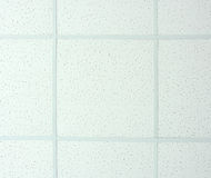 Hanging white ceiling. Hanging white  styrofoam tiled ceiling. Photo texture Royalty Free Stock Images