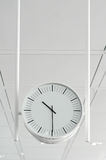 Hanging white clock Royalty Free Stock Photos