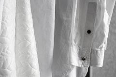 Hanging white fresh washed clothes royalty free stock photography
