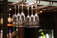 Hanging wine glasses Stock Image