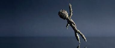 Hanging Wire man. On blue gradient background Royalty Free Stock Photo