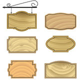 Hanging wood sign shapes. Vector set of wooden signs with wrought iron bracket Stock Images
