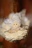 Hanging wooden angels Stock Images