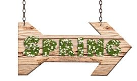 Hanging wooden arrow as a signpost with Spring text on white background. Hanging wooden arrow as a pointer with rustic style and text Spring with green grass and Stock Photos