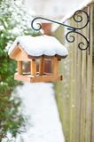 Hanging Wooden Bird Feeder Covered By Snow In Winter. Royalty Free Stock Photo