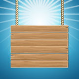 Hanging wooden blank sign board blue sky Royalty Free Stock Photos