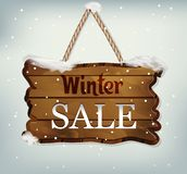 Hanging wooden sign with the text winter sale. Hanging, wooden Board pointer on blue background. vector, wooden object with text winter sales royalty free illustration