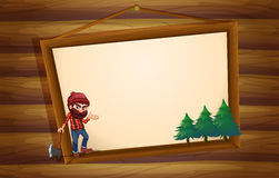 A hanging wooden frame with a woodman Stock Images
