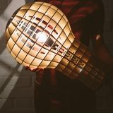 Hanging, wooden light shade lamp with bulb Stock Photo