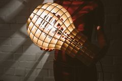 Hanging, wooden light shade lamp with bulb Royalty Free Stock Photo