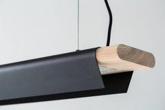 Hanging wooden-metallic lamp Royalty Free Stock Image