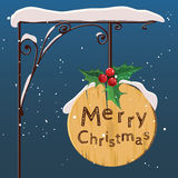Hanging wooden sign. Merry christmas. Vector. Royalty Free Stock Photography