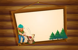 A hanging wooden signboard with a lumberjack chopping the woods Royalty Free Stock Image