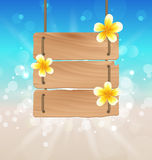 Hanging wooden signboard with tropical flowers frangipani Stock Photos