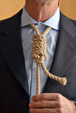 Hangman adjusting a  rope like tie. Stock Image