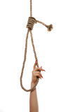 Hangman's noose. The beautiful female hand, embraces a loop Stock Photography