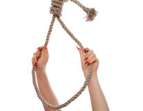 Hangman's noose. The beautiful female hand, embraces a loop Stock Images