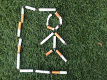 Hangman symbol from cigarette. Dead massage hangman from cigarette for healthy concept stock image