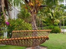 Hangmat in de tuin Stock Afbeelding