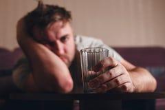 Hangover depressed man after hard drinking. Stock Photos
