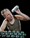 Hangover. The man examines, whether there is no beer drop in a can Stock Images