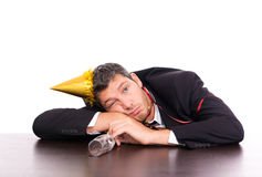 Hangover man after party. Man in hangover after big party hanging down on table Royalty Free Stock Photos