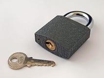 Hangslot en sleutel. Stock Afbeelding