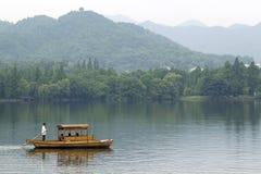 Hangzhou. Traditional row boat on West Lake, Hangzhou, China royalty free stock photos