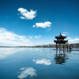 Hangzhou china. Ancient pavilion against a blue sky and reflection in the west lake at hangzhou,China Stock Image
