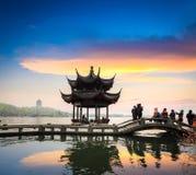 Hangzhou in sunset. Beautiful west lake scenery at dusk in hangzhou,China royalty free stock photo