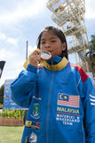 Hanifah Aaliyah Yoong. PUTRAJAYA, MALAYSIA-OCTOBER 9: Hanifah Aaliyah Yoong 8 years old from Malaysia wins the bronze medal at 2011 IWWF Asian Waterski & Stock Photo