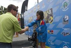 Hanifah Aaliyah Yoong 8 years old from Malaysia. PUTRAJAYA, MALAYSIA - OCTOBER 9: The winners of open ladies tricks at 2011 IWWF Asian Waterski & Wakeboard Royalty Free Stock Photos