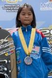 Hanifah Aaliyah Yoong 8 years old from Malaysia. PUTRAJAYA, MALAYSIA-OCTOBER 9: Hanifah Aaliyah Yoong 8 years old from Malaysia wins the bronze medal at 2011 Stock Photos