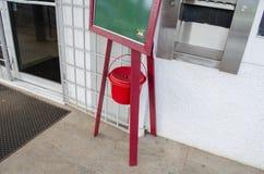 Haning Donation Bucket stock photography