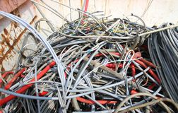 Hank of cord amassed in a container in waste landfill Stock Photos