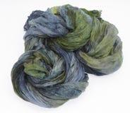 Hank of a dark-green silk fabric. A hank of a dark-green silk fabric Royalty Free Stock Image