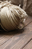 Hank jute rope on a background of wooden planks Royalty Free Stock Photography