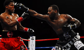 Hank Lundy lands a punch on Dannie Williams Stock Photo