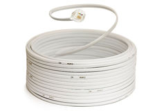 Hank of phone cable. Coil of telephone cord with RJ11 plug Royalty Free Stock Photos