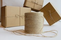 hank of rope and cardboard gift boxes stock images