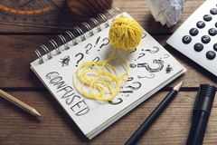 Hank of rope with Sketchbook and drawing of question marks Royalty Free Stock Photos