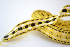 Hank tape. Skein of yellow tape for decoration Royalty Free Stock Images