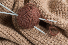 Hank of wool, needles  and   knitting Royalty Free Stock Images