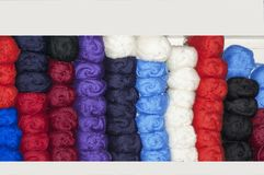 Color yarn for knitting. Hanks of color yarn for knitting in shop Royalty Free Stock Photos