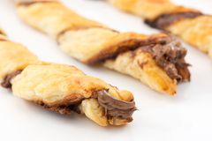 Hanks of puff pastry with chocolate royalty free stock photography