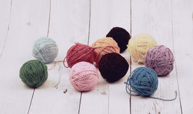 Hanks are set out in a pile. wood background. Concept and Decorative wool yarn balls Royalty Free Stock Images