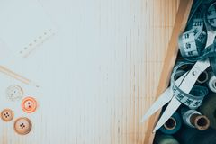 Hanks thread, steel scissors and centimeter for sewing as background. Royalty Free Stock Photography