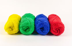 Four skeins of yarn. Four colorful skeins of wool yarn. Isolated. Close up Royalty Free Stock Photography