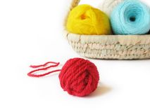 Hanks of the yarn for knitting in basket Royalty Free Stock Photo